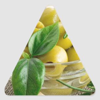 Pitted olives with green leaves and rosemary triangle sticker