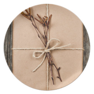 Plain gift with natural decorations plates
