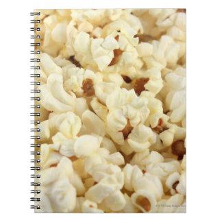 Plain popcorn close up. spiral note book