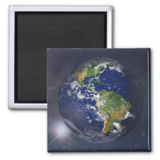 Planet earth rising above the sun in space square magnet