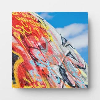 planet graffiti plaque