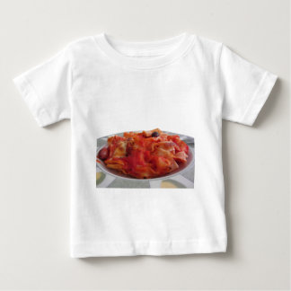 Plate of home made baked pasta on white background baby T-Shirt