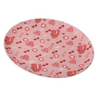 Plate strawberries and cherries