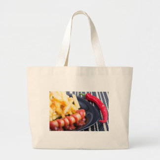 Plate with a portion of fried potatoes large tote bag