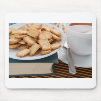 Plate with crackers and cup of tea mouse pad