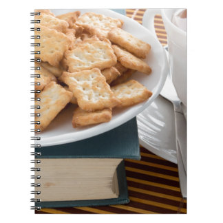 Plate with crackers and cup of tea notebook
