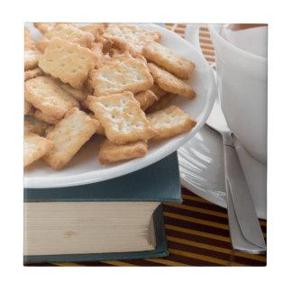 Plate with crackers and cup of tea tiles