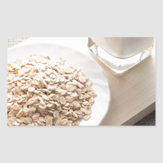 Plate with dry cereal and a glass of milk