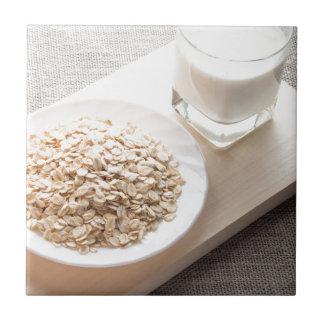Plate with dry cereal and a glass of milk ceramic tiles