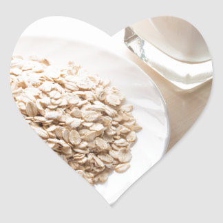 Plate with dry cereal and a glass of milk heart sticker