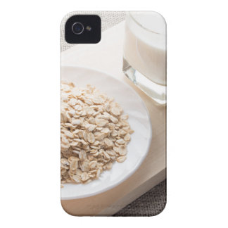 Plate with dry cereal and a glass of milk iPhone 4 case