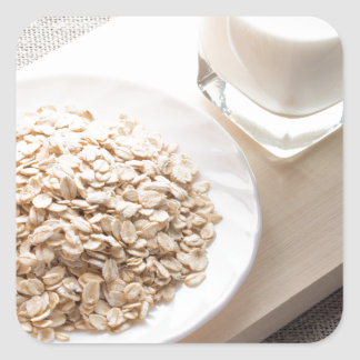 Plate with dry cereal and a glass of milk square sticker