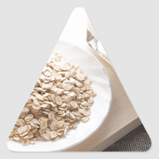 Plate with dry cereal and a glass of milk triangle sticker