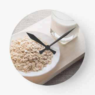 Plate with dry cereal and a glass of milk wall clocks