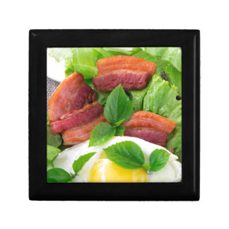Plate with egg yolk, fried bacon and herbs gift box