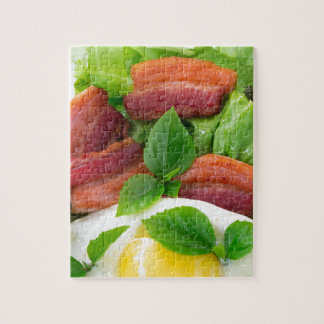 Plate with egg yolk, fried bacon and herbs jigsaw puzzle