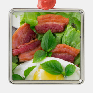 Plate with egg yolk, fried bacon and herbs metal ornament