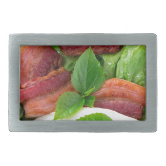 Plate with egg yolk, fried bacon and herbs rectangular belt buckles