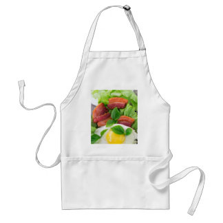 Plate with egg yolk, fried bacon and herbs standard apron