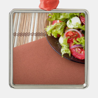 Plate with fresh salad of raw tomatoes and lettuce Silver-Colored square ornament