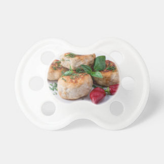 Plate with fried meatballs minced chicken baby pacifiers