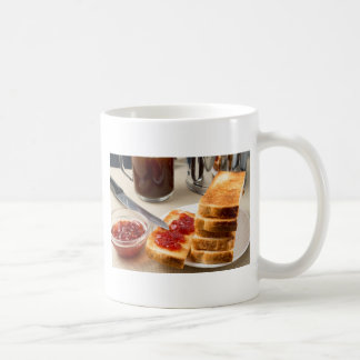 Plate with fried slices of bread for breakfast coffee mug