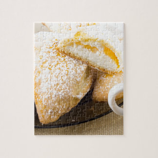Plate with sweet pastries with sweet cheese puzzles