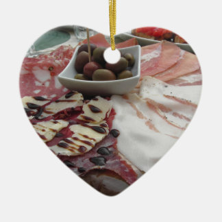 Platter of cold cuts with rustic ham prosciutto ceramic heart ornament
