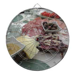 Platter of cold cuts with rustic ham prosciutto dartboard