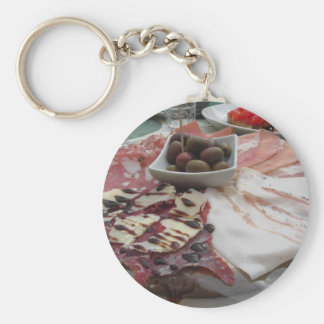 Platter of cold cuts with rustic ham prosciutto keychain