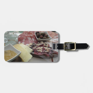Platter of cold cuts with rustic ham prosciutto luggage tag