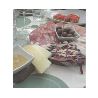 Platter of cold cuts with rustic ham prosciutto notepad