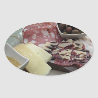 Platter of cold cuts with rustic ham prosciutto oval sticker