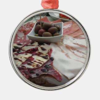 Platter of cold cuts with rustic ham prosciutto Silver-Colored round ornament