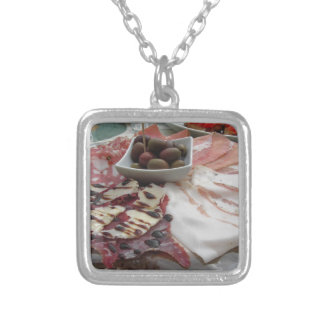 Platter of cold cuts with rustic ham prosciutto silver plated necklace