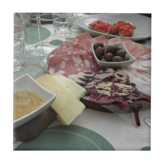 Platter of cold cuts with rustic ham prosciutto tile