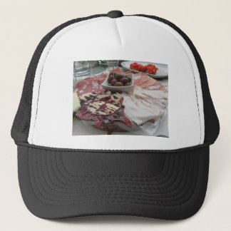 Platter of cold cuts with rustic ham prosciutto trucker hat