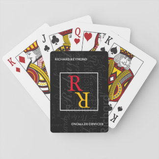 player monogram on black playing cards