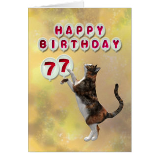 Playful cat and 77th Happy Birthday balloons Card