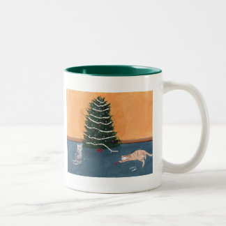 Playful Christmas cats by the tree Mug
