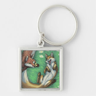 Playful foxes keychain