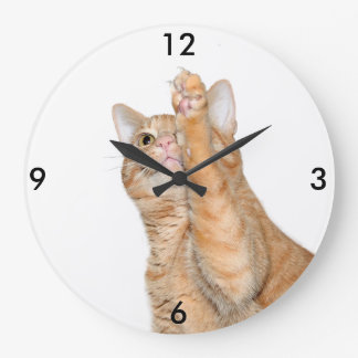 Playful orange tabby cat large clock