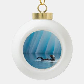 Playful Sea Otter Ceramic Ball Christmas Ornament