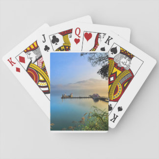 Playing cards with water scenery