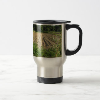 Plowed field in the late afternoon in Tuscany Travel Mug