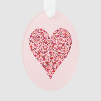 Pois cramoisi de forme de coeur sur le rose