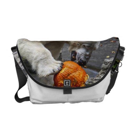 Polar Bear Eating a Pumpkin Messenger Bags