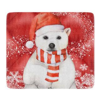 polar bear in a santa cap - snowflakes w white cutting board
