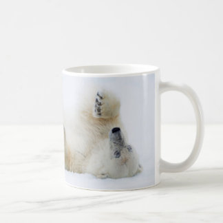 Polar bear rolling in snow, Norway Coffee Mug