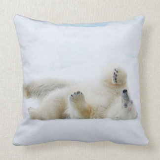 Polar bear rolling in snow, Norway Throw Pillow